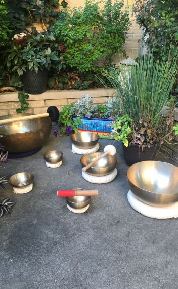 Multiple therapeutic singing bowls